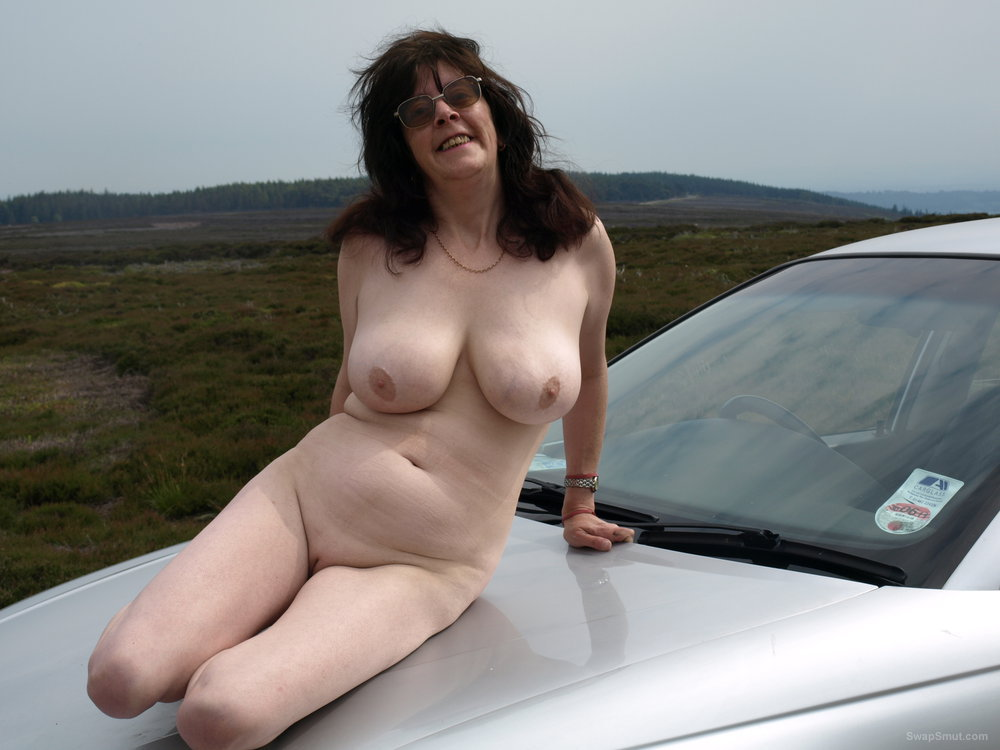 Wife naked on her car at a Quick Fuck meet.